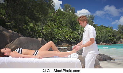 personal physiotherapist on the beach - physiotherapist...