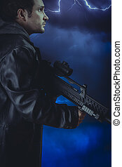 Man with long leather jacket and assault rifle over storm...