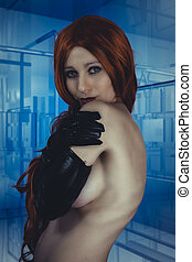 Fetish red hair model posing in black latex outfit over...