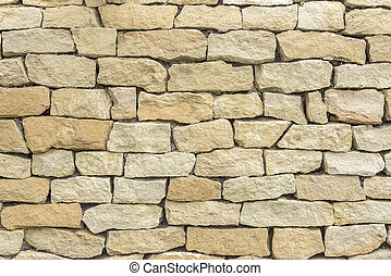 Old yellow brick wall. - The Background with old yellow...