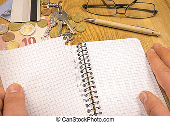 Blank sheet torn from a spiral notebook - Conceptual image...