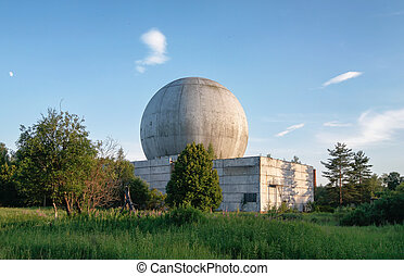 Old big dome of a radar antenna on the roof of the building of a Russian military base