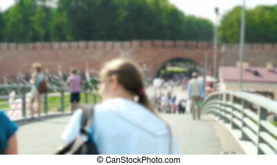 Many people walking on a pedestrian bridge - The crowded...
