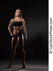 Full length photo of sexy female bodybuilder poses - Full...