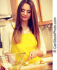 Woman housewife in kitchen cutting apple fruits - Woman...