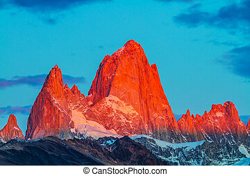 The cliffs Fitz Roy in crimson light of sunset - Sharp tops...