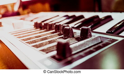 Keyboard of a synthesizer with sliders. - Keyboard of a...