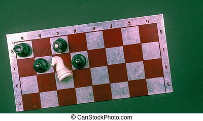 Various board games and figurines over checkers board - Stop...