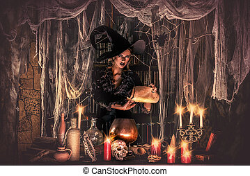 Halloween light - Attractive witch conjures in the wizarding...