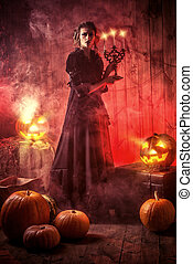 frightening hallowen - Scary attractive witch in an...