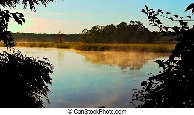 fog and steam lake reflection - fog and steam over the...