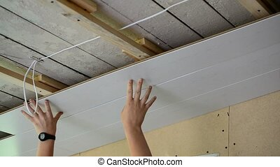 Two Workers makes the ceiling of MDF panels - Worker makes...