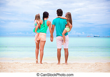 Family beach vacation - Happy beautiful family on a tropical...