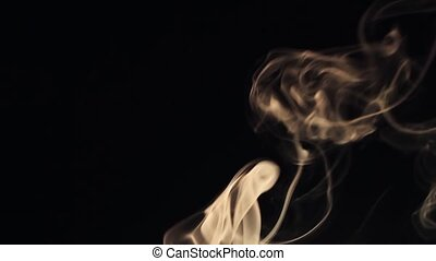 Beautiful wisp of smoke on a black background. Warm tone HD