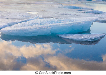 Ice breaking in Jakulsalon lagoon, natural winter landscape...