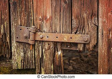 Rusty door hinge - Image of old worn door with rusty hinge.