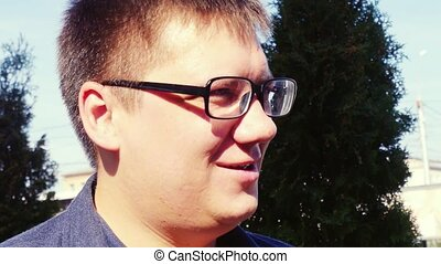 Young caucasian man portrait outdoor in glasses. 1920x1080....