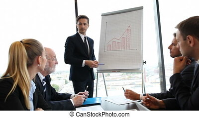 Businesspeople at presentation - Businesspeople discussing...