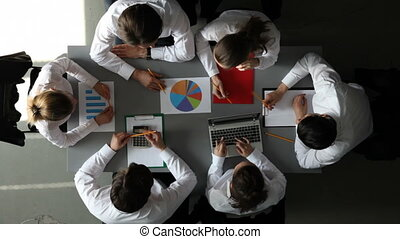 Business team with financial report - Team of business...