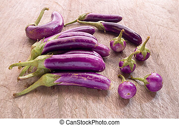 Round and long fresh organic raw purple brinjal or eggplant...