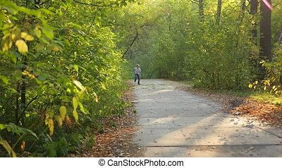 child running along a path in a park - the child runs a...