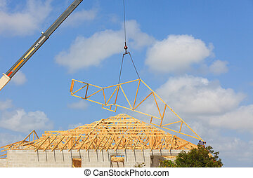 Roof Truss, Construction - Roof Truss hanging from a crane...