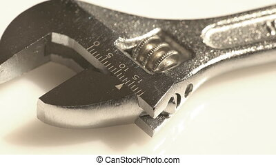An adjustable wrench macro view - A macro view of a steel...