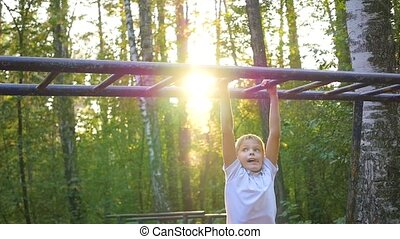 the child climbs on a horizontal ladder - the child is...