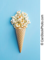Popcorn in ice cream cones.