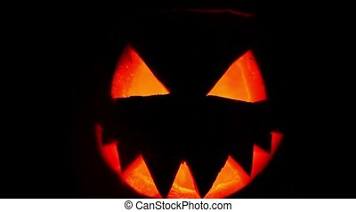 scary pumpkin faces smiling in the dark, leave the...