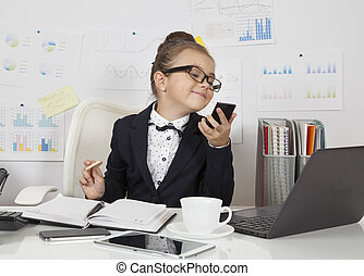 Little girl doing make-up - Smart little business girl doing...
