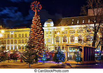 Wooden Christmas tree and market at night in Riga