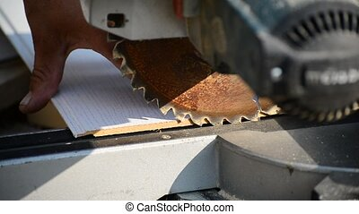 Man sawing MDF board with circular saw - Man sawing MDF...