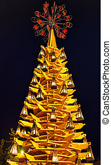 Wooden Christmas tree at night in the center of Riga