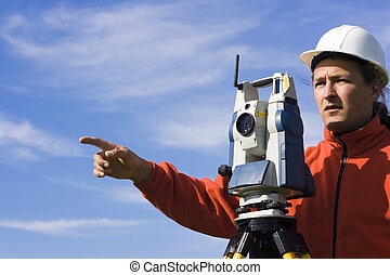 Land Surveyor in the field - spring surveying