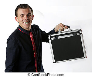 portrait of a young business man with a briefcase in his...
