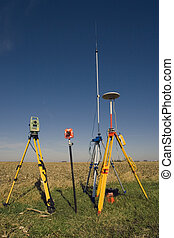 GPS unit, Total station and Prism set in the field.