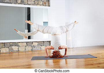 Yoga headstand Sirsasana upside down at gym - Yoga headstand...