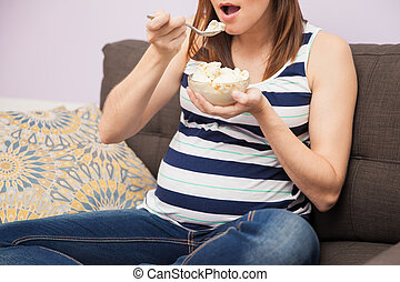Pregnant woman eating ice cream