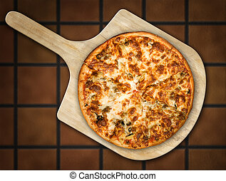 Pizza on Wooden Peel - Pizza resting on a wooden pizza peel...
