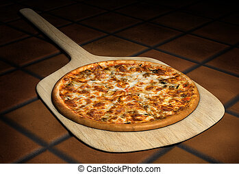 Pizza on a Wooden Peel - Pizza resting on a wooden pizza...