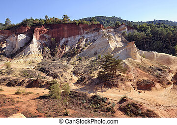 red landscape dug by six generations of miners ocher...