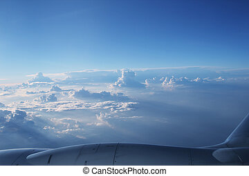 Looking through window aircraft during flight with a blue...