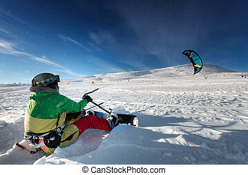 Snowboarder skydives on blue sky backdrop in mountains...