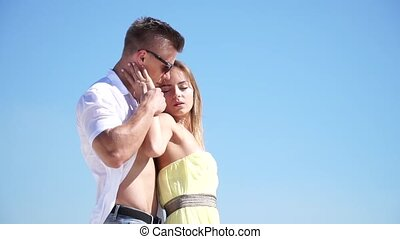 Loving couple embracing in the desert in the wind