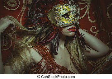 Celebration, blonde with Venetian mask in gold and red,...