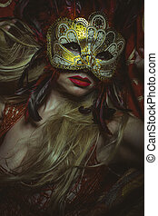 Party, blonde with Venetian mask in gold and red,...