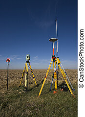 GPS unit, Total station and Prism set in the field