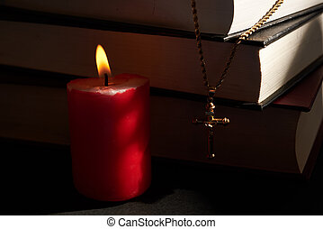 cross, candles and books - cross, lighted candles and books