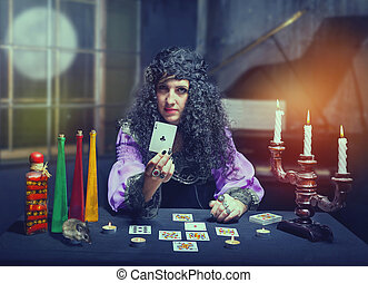 Sorceress telling fortunes using cards, she shows holeinone
